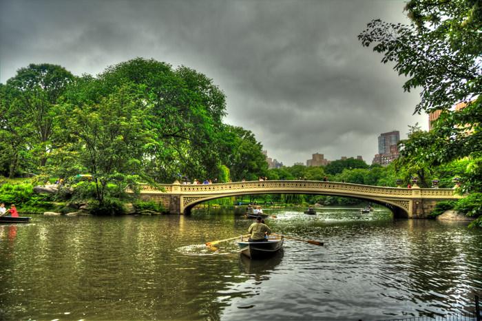 Row Boats in New York City's Central Park near the Bow Bridge.