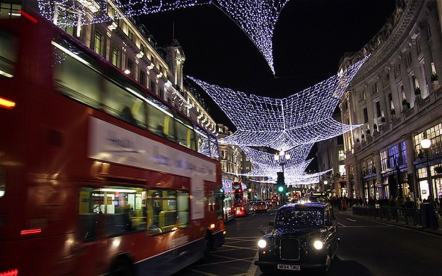 Christmas lights with taxi and double decker bus in Regents Street London UK. Image shot 12/2008. Exact date unknown.