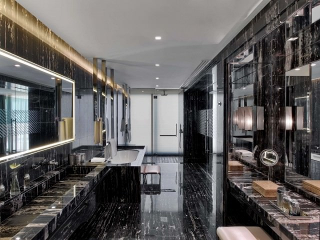 the-bathroom-also-has-a-glass-enclosed-rainforest-shower-a-freestanding-glass-enclosed-bathtub-and-19-inch-mirror-television-theres-also-a-full-bathroom-dressing-room-and-a-powder-room-adjacent-to-the-chamber