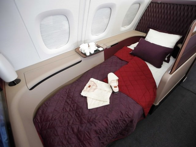 first-class-seats-can-be-flattened-into-actual-beds-so-its-easy-to-sleep-and-pjs-and-slippers-are-complimentary