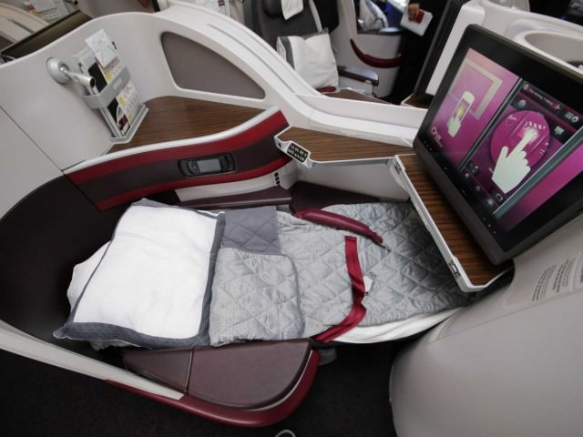 some-business-class-seats-are-extra-wide-and-feature-a-180-degree-lie-flat-bed