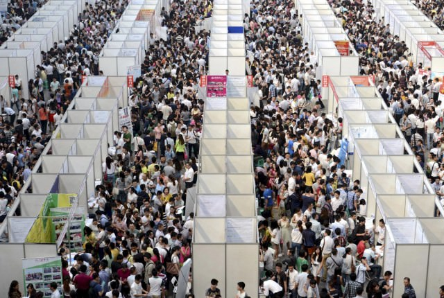 thousands-of-job-seekers-visit-booths-inside-a-job-fair-in-chongqing