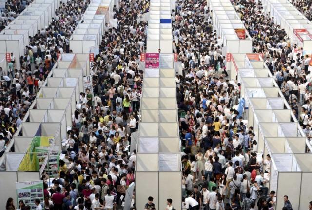 thousands-of-job-seekers-visit-booths-inside-a-job-fair-in-chongqing