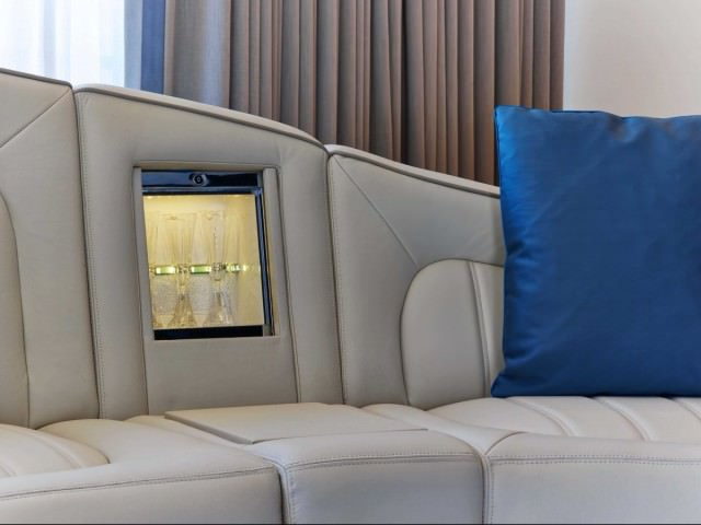 hidden-in-the-sofa-is-a-built-in-champagne-bar-which-slides-open-to-reveal-