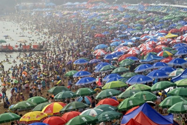 people-crowd-on-a-beach-in-dalian-liaoning-province-to-escape-the-summer-heat
