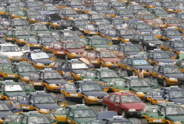 taxi-drivers-line-up-in-a-parking-lot-while-waiting-for-passengers-at-the-new-beijing-capital-international-airport