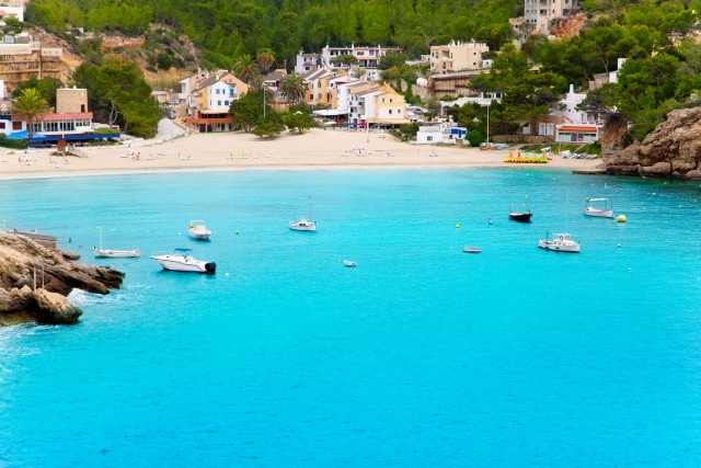 Cala Vadella in Ibiza with turquoise water in balearic islands